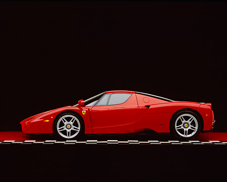 FRR 04 RK0295 04 © Kimball Stock 2003 Ferrari Enzo Red Profile View On Checkered Line Red Floor Studio