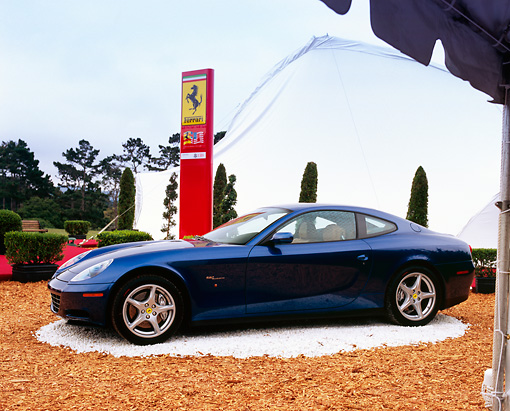 FRR 04 RK0316 02 © Kimball Stock 2004 Ferrari 612 Scaglietti Blue 3/4 Front View On Display