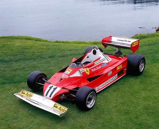 FRR 04 RK0348 02 © Kimball Stock 1977 Ferrari 312T2 Formula One Red Overhead 3/4 Front View On Grass By Water