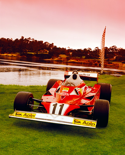 FRR 04 RK0349 01 © Kimball Stock 1977 Ferrari 312T2 Formula One Red 3/4 Front View On Grass By Water