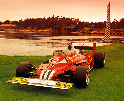 FRR 04 RK0350 03 © Kimball Stock 1977 Ferrari 312T2 Formula One Red 3/4 Front View On Grass By Water