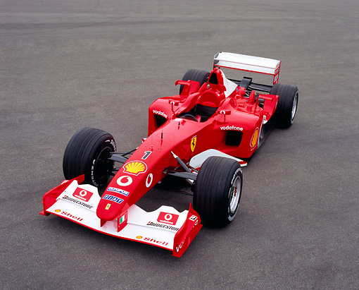 FRR 04 RK0353 02 © Kimball Stock 2003 Michael Schumacher Ferrari Formula One Red Overhead 3/4 Front View On Pavement