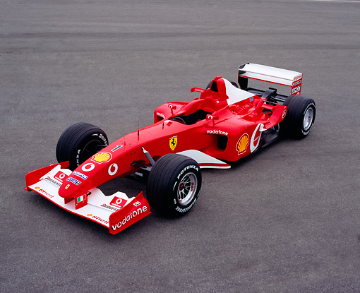 FRR 04 RK0354 04 © Kimball Stock 2003 Michael Schumacher Ferrari Formula One Red Overhead 3/4 Side View On Pavement