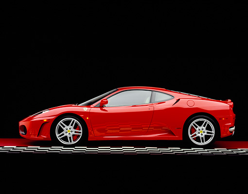 FRR 04 RK0359 08 © Kimball Stock 2005 Ferrari F430 Red Profile View On Checkered Line Studio