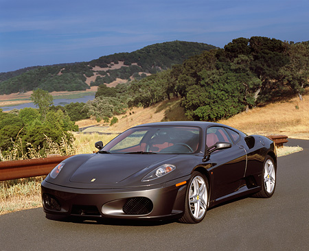 FRR 04 RK0377 01 © Kimball Stock 2005 Ferrari F430 Grigio Silverstone 3/4 Front View On Pavement By Hills And Trees