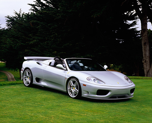 FRR 04 RK0390 05 © Kimball Stock 2005 Ferrari 360 Spyder Silver 3/4 Side View On Grass By Trees