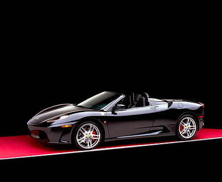 FRR 04 RK0402 01 © Kimball Stock 2005 Ferrari F430 Spider Black 3/4 Side View On Red Floor Studio
