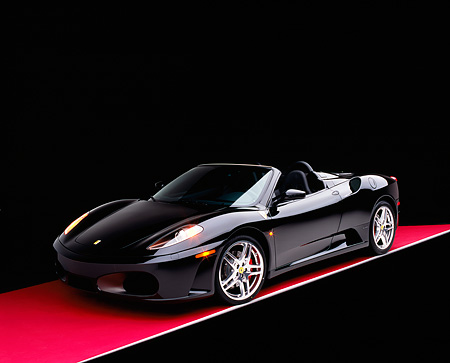 FRR 04 RK0403 01 © Kimball Stock 2005 Ferrari F430 Spider Black 3/4 Front View On Red Floor Studio