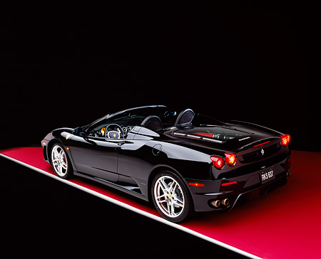 FRR 04 RK0405 01 © Kimball Stock 2005 Ferrari F430 Spider Black 3/4 Rear View On Red Floor Studio