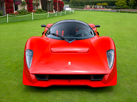 FRR 04 RK0420 01 © Kimball Stock Ferrari P4/5 Red By Pininfarina Head On View On Turf