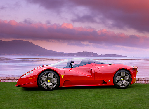 FRR 04 RK0424 01 © Kimball Stock Ferrari P4/5 Red By Pininfarina Profile View On Turf