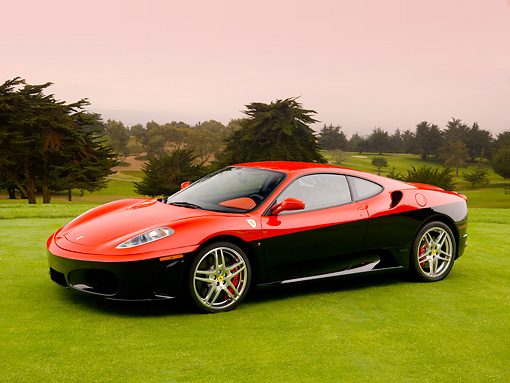 FRR 04 RK0434 01 © Kimball Stock 2006 Ferrari F430 Red And Black 3/4 Side View On Grass