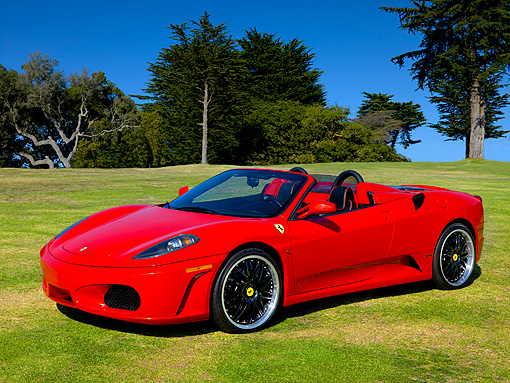 FRR 04 RK0451 01 © Kimball Stock 2006 Ferrari F430 Spyder Red 3/4 Side View On Grass By Trees