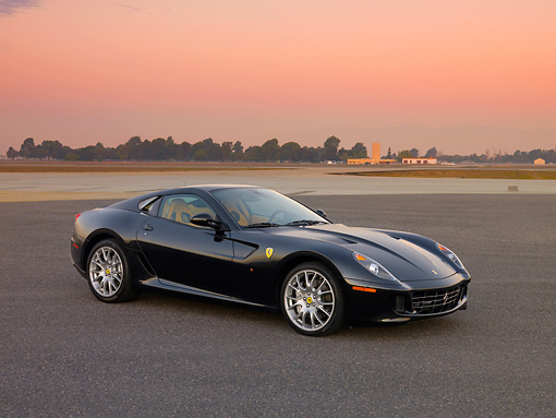 FRR 04 RK0478 01 © Kimball Stock 2007 Ferrari 599 GTB Fiorano Black 3/4 Side View On Pavement