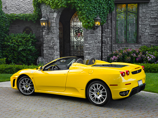 FRR 04 RK0562 01 © Kimball Stock 2006 Ferrari F430 Spider Yellow 3/4 Rear View By Mansion