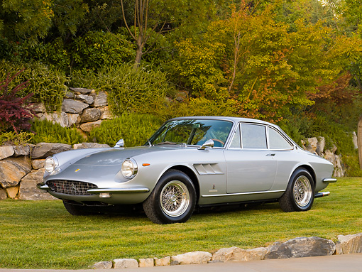 FRR 04 RK0589 01 © Kimball Stock 1967 Ferrari 330 GTC Silver 3/4 Front View On Grass By Trees