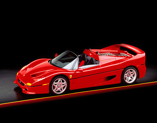 FRR 05 RK0009 18 © Kimball Stock 1996 Ferrari F-50 Red 3/4 Side View On Red And Yellow Lines Studio