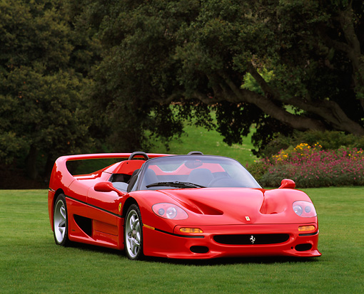 FRR 05 RK0047 03 © Kimball Stock 1996 Ferrari F-50 Red 3/4 Front View On Grass Trees Background