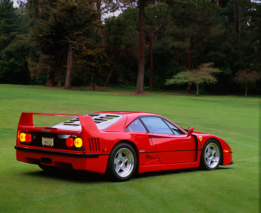 FRR 06 RK0024 01 © Kimball Stock 1990 Ferrari F-40 Red 3/4 Rear View On Grass Trees Background