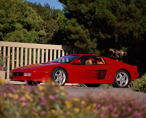 FRR 07 RK0071 04 © Kimball Stock 1992 Ferrari Testarosa Red Low 3/4 Front View By Flowers Gate Trees