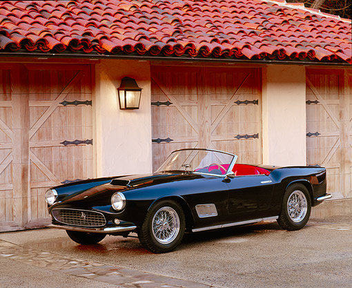 FRR 08 RK0044 01 © Kimball Stock 1959 Ferrari California Spider Black 3/4 Front View By Garage