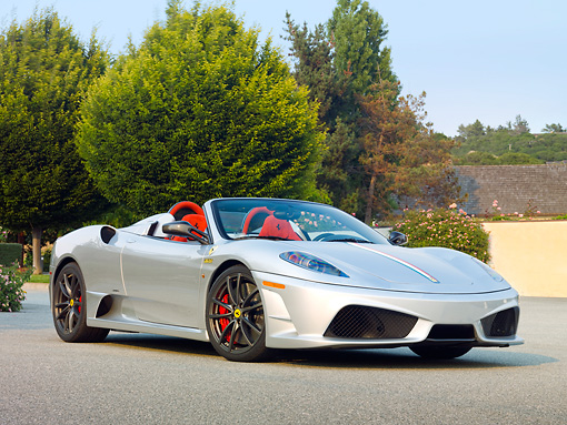 FRR 08 RK0126 01 © Kimball Stock 2009 Ferrari F430 16M Scuderia Spider Silver 3/4 Front View On Pavement By Trees