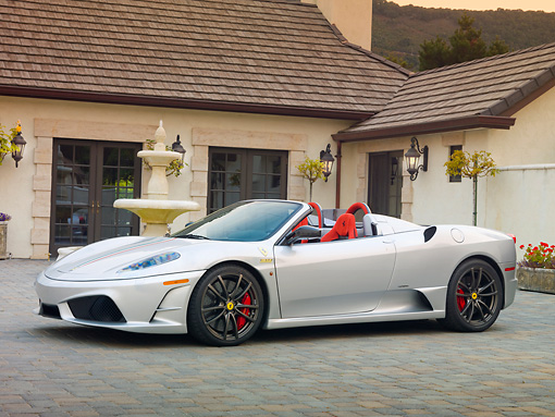 FRR 08 RK0129 01 © Kimball Stock 2009 Ferrari F430 16M Scuderia Spider Silver 3/4 Front View On Pavement By House