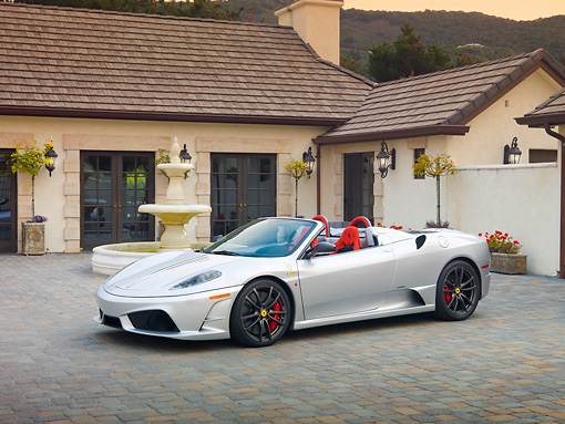 FRR 08 RK0130 01 © Kimball Stock 2009 Ferrari F430 16M Scuderia Spider Silver 3/4 Front View On Pavement By House