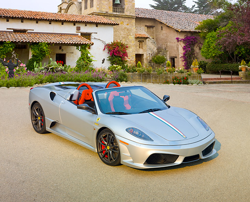 FRR 08 RK0134 01 © Kimball Stock 2009 Ferrari F430 16M Scuderia Spider Silver 3/4 Front View On Pavement By Building