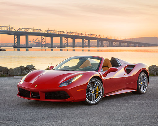 FRR 08 RK0165 01 © Kimball Stock 2016 Ferrari 488 Spyder Red 3/4 Front View On Edge Bay With Bridge In Background