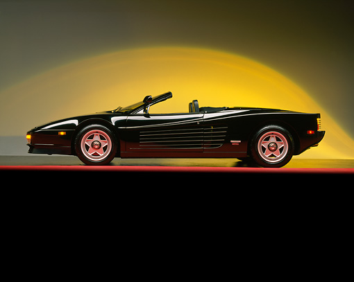 FRR 08 RK0053 01 © Kimball Stock Ferrari Testarossa Spyder Black Profile View Red Line Yellow Lighting Studio
