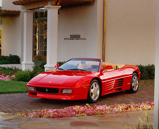 FRR 08 RK0097 02 © Kimball Stock 1994 Ferrari 348 Spyder Red Front 3/4 View By Flowers And Building