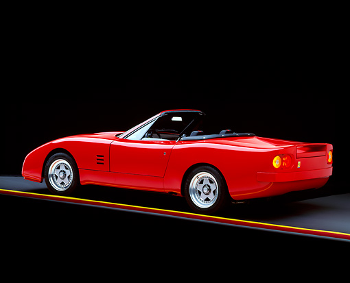 FRR 08 RK0117 02 © Kimball Stock 1969 Ferrari 365 NART Spyder Red Convertible 3/4 Rear View On Gray Line Studio