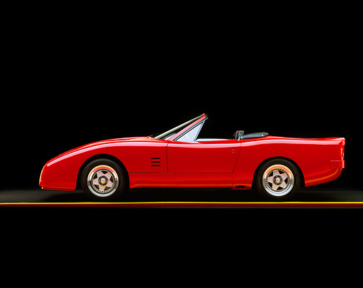FRR 08 RK0118 02 © Kimball Stock 1969 Ferrari 365 NART Spyder Red Profile View On Yellow Line Studio