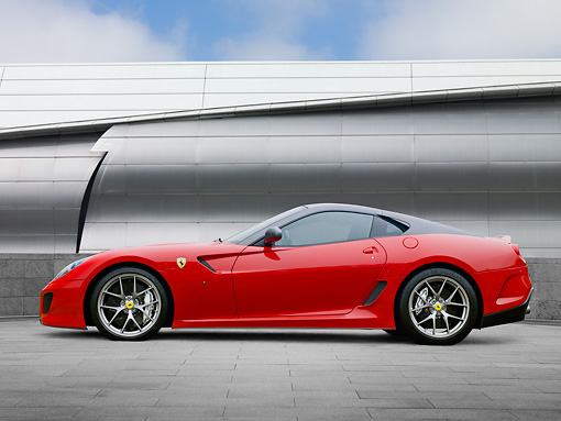 FRR 09 RK0057 01 © Kimball Stock 2011 Ferrari 599 GTO Red Profile View On Pavement By Metal Structure