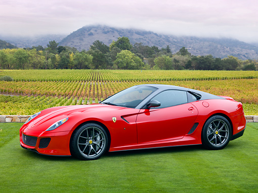 FRR 09 RK0058 01 © Kimball Stock 2011 Ferrari 599 GTO Red 3/4 Front View On Grass By Vineyard