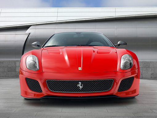 FRR 09 RK0061 01 © Kimball Stock 2011 Ferrari 599 GTO Red Head On View On Pavement By Metal Structure