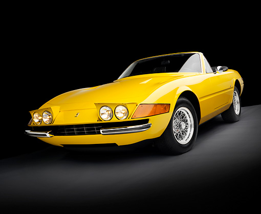 FRR 12 RK0008 01 © Kimball Stock 1971 Ferrari Daytona Spyder GTB/4 Yellow 3/4 Front View In Studio.