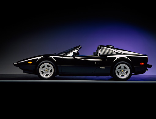 FRR 13 RK0007 01 © Kimball Stock 1984 Ferrari 308 Black Side View On Gray Line Blue Lighting Background Studio