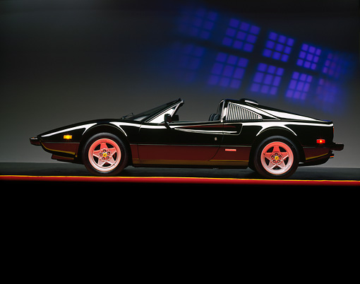 FRR 13 RK0001 03 © Kimball Stock 1984 Ferrari 308 Black Profile View On Red Line Blue Squares Background Studio