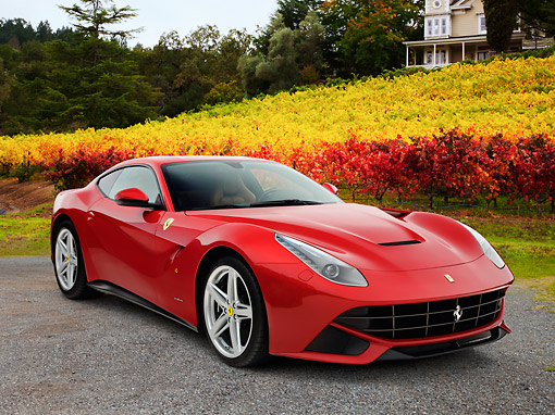 FRR 15 RK0043 01 © Kimball Stock 2012 Ferrari F12 Berlinetta Red 3/4 Front View On Gravel By Vineyard