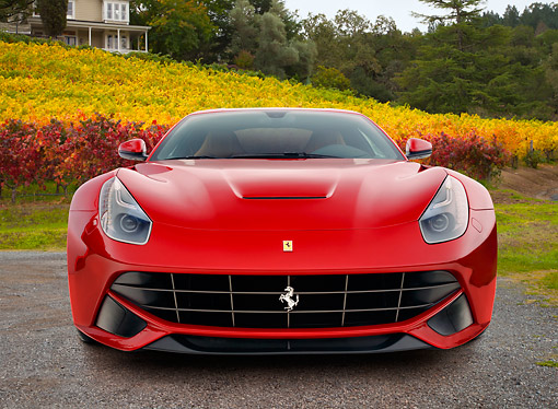 FRR 15 RK0044 01 © Kimball Stock 2012 Ferrari F12 Berlinetta Red Front View On Gravel By Vineyard