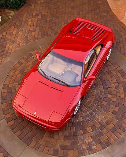 FRR 15 RK0017 02 © Kimball Stock 1995 Ferrari F355 Berlinetta Red Ovehread 3/4 Front View On Brick