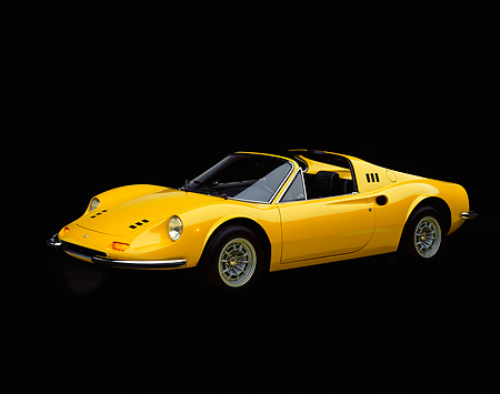 FRR 16 RK0002 01 © Kimball Stock 1973 Yellow Ferrari 246 GTS Dino 3/4 Side View Studio Background
