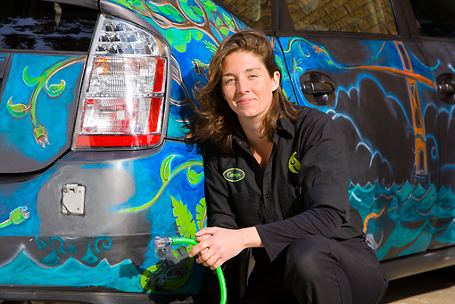 GAR 01 RK0018 01 © Kimball Stock Female Mechanic Checking Toyota Prius At Luscious Garage: Hybrid Specialists