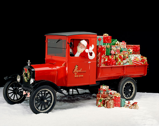 GCD 02 RK0009 10 © Kimball Stock Santa Clause In 1920 Ford Model T Red Truck With Christmas Presents On Snow Studio