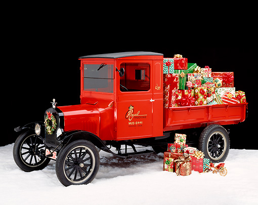 GCD 02 RK0011 05 © Kimball Stock 1920 Ford Model T Red Truck With Christmas Presents On Snow Studio