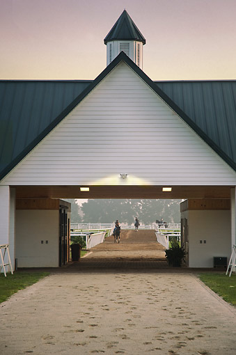 HOR 01 MB0492 01 © Kimball Stock Thoroughbred Horse Farm Training Barns Under Pink Sky