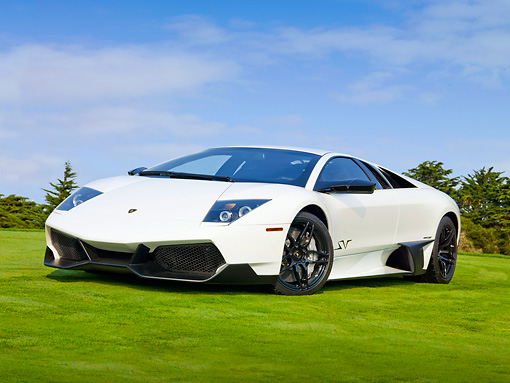 LAM 01 BK0003 01 © Kimball Stock 2010 Lamborghini Murci�lago LP670-4 SuperVeloce White 3/4 Front View On Grass