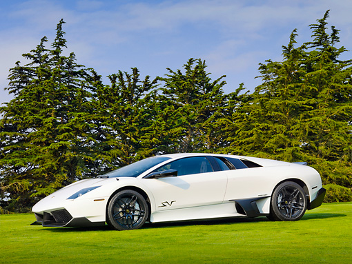 LAM 01 BK0004 01 © Kimball Stock 2010 Lamborghini Murci�lago LP670-4 SuperVeloce White Profile View On Grass